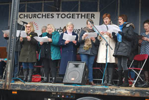 Choir singing on the truck 'stage' at Market Harborough's Good Friday 2015 event in the town square