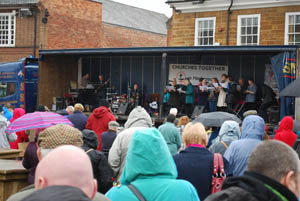 Crowd and choir singing at Market Harborough's Good Friday 2015 event in the town square