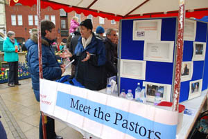Street Pastors stall at Market Harborough's Good Friday 2015 event in the town square